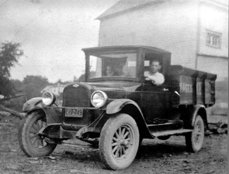 A black and white photo of Jacob and Mary Agnes sitting in a delivery truck in 1927.