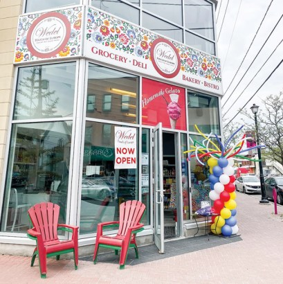 Wedel - Touch of Europe is seen on its opening day with ballons and red deck chairs out front