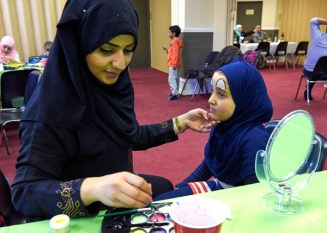 Facepainting at the Ottawa Mosque open house. Photo by Ellen Bond