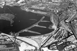 This photo from 1962 shows Nepean Bay being filled in where the parkway now runs (so a little outside Kitchissippi to the east. The old roundhouse at Bayview is at bottom, but it shows just how much fill had to go in to make it happen.) Photo courtesy of the City of Ottawa Archives