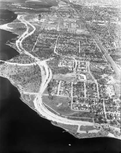 """This aerial photo is from 1963. Westboro Beach is at the bottom and the view looks westward past Tunney's Pasture, etc. """"This is my favourite shot,"""" writes Dave Allston, """"with the parkway still under development, and (sadly) all the old roads that had cottages and houses all the way to the water now little ghost towns, Champlain Park especially."""" Photo courtesy of the City of Ottawa archives"""