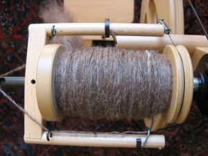 My first-ever bobbin spun on my new wheel.