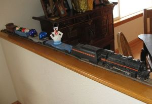 My husband's old train set reminds him of Christmas Past. I added some ornaments to make it look festive.