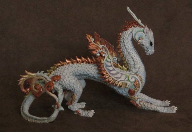 Painted dragon sculpture made from polymer clay, foil, and wire by Kim Rhodes