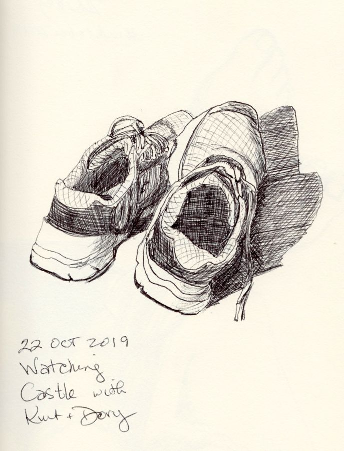 Black and white ink drawing of tennis shoes by Kit Dunsmore