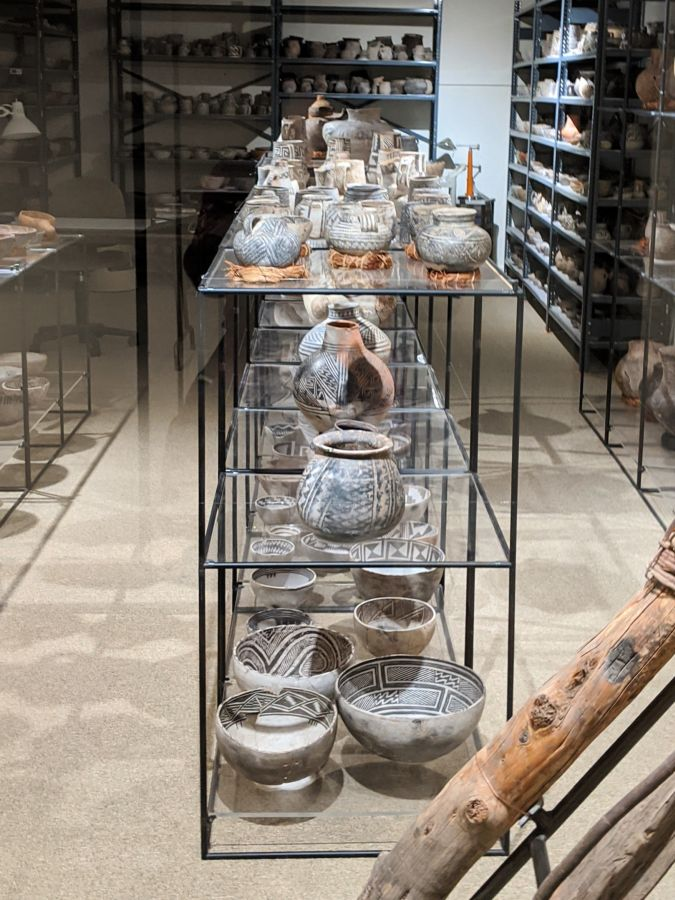 Shelves of pottery in glass display room. The Edge of the Cedars State Park museum, Blanding, Utah. Photo by Kit Dunsmore