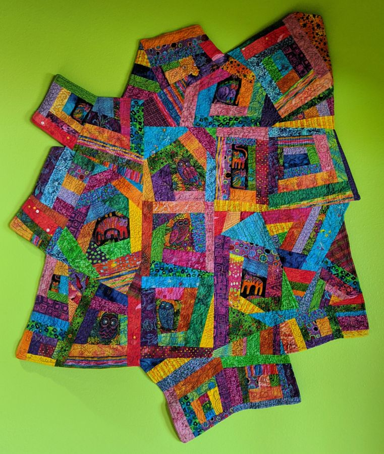 Abstract quilt with wonky blocks and irregular shape made in bright candy colors. Quilt by Kit Dunsmore