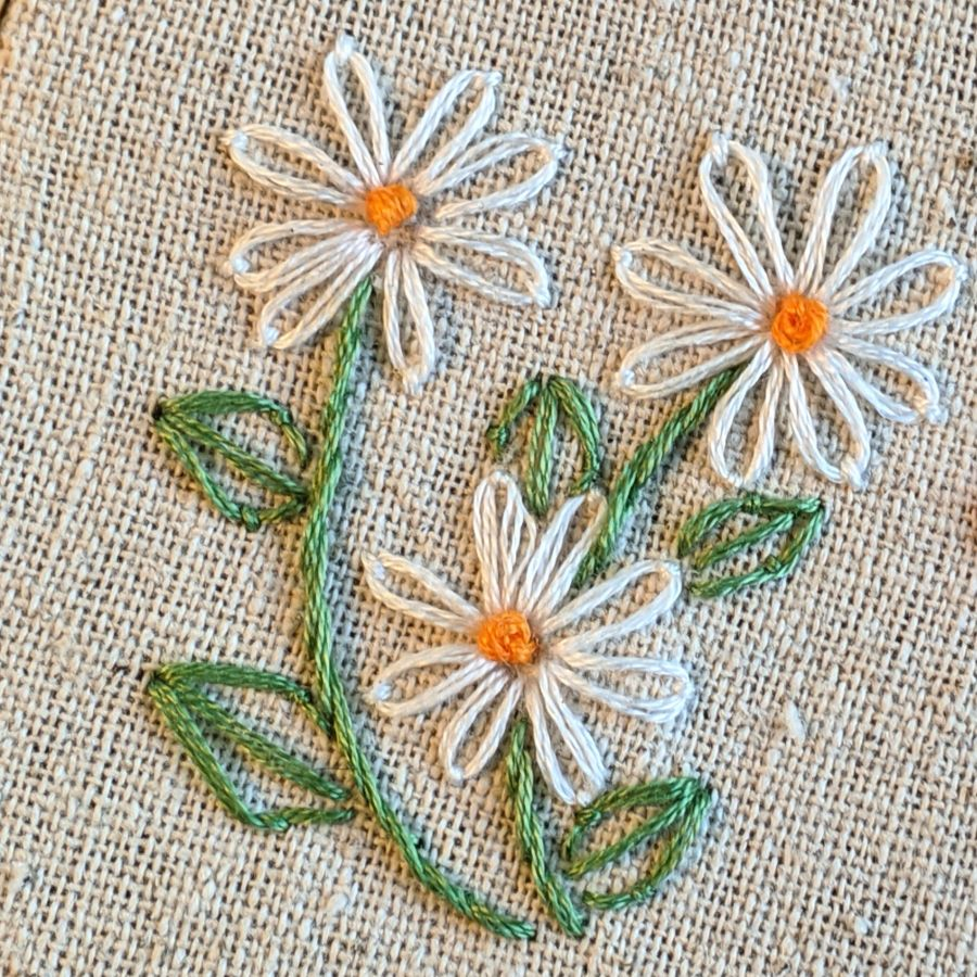 Close up of embroidered daisies by Kit Dunsmore