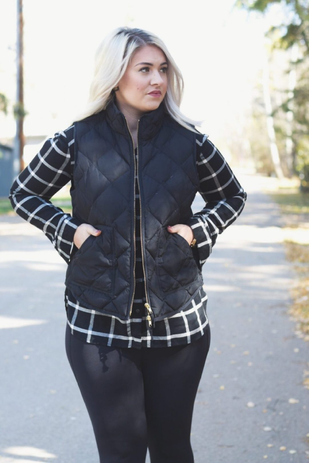Plaid shirt and puffer vest outfit