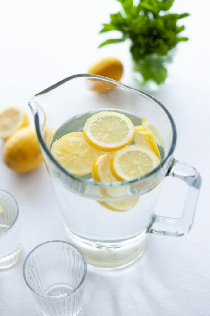 lemons slices hanging out and chatting in a pitcher of water