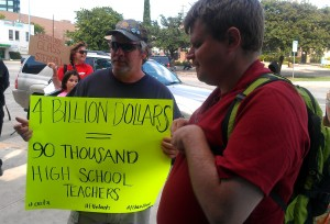 Sign at Chase Bank: 4 Billion Dollars Would Buy 90K High School Teacher Salaries