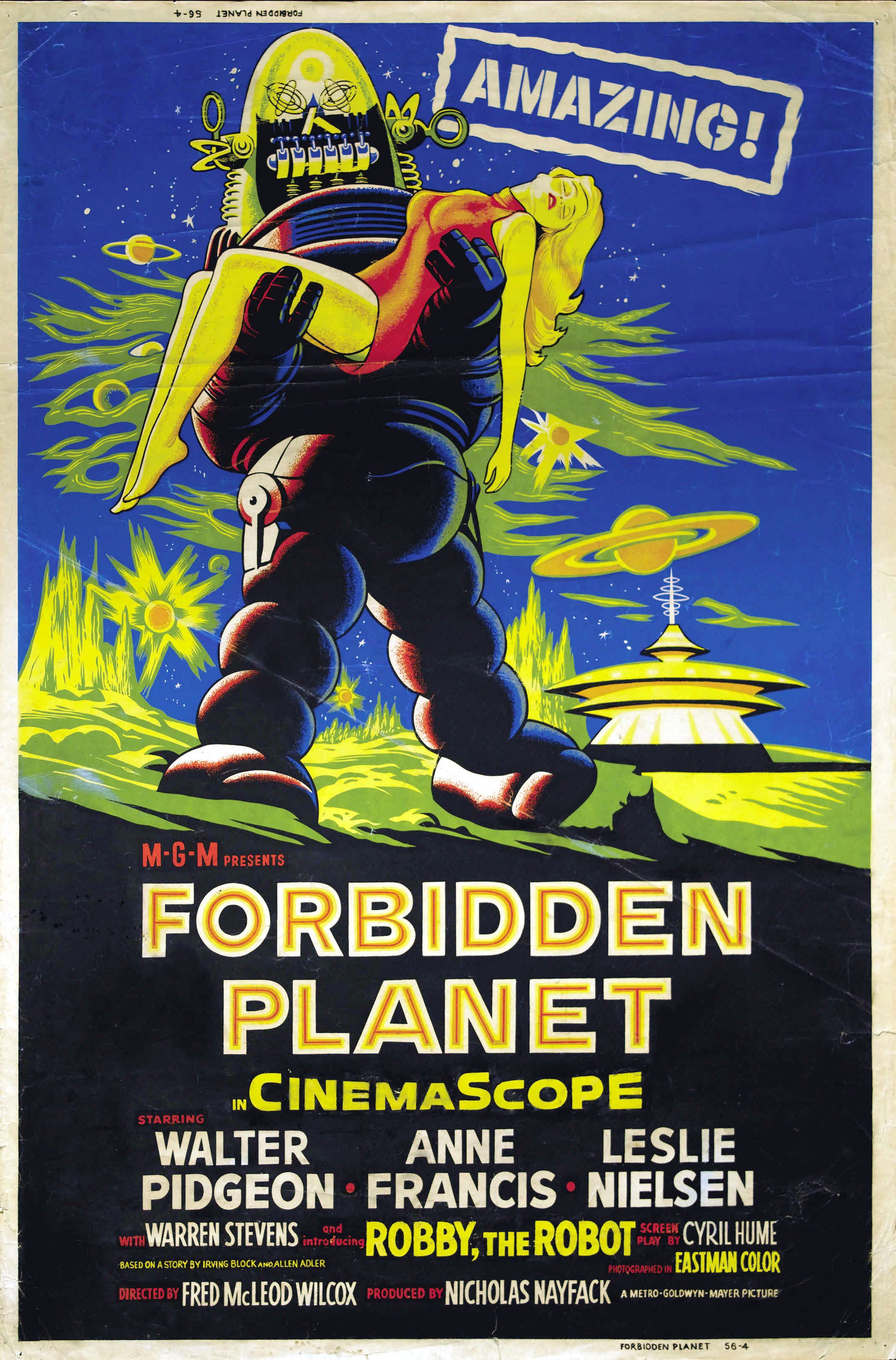 Robbie the Robot carries an unconscious blond woman on the poster for Forbidden Planet.