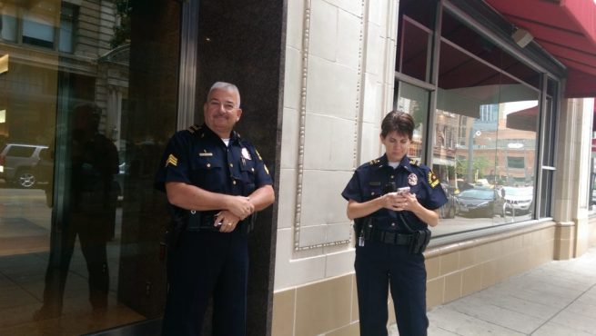 In this July 31, 2014 photograph, Dallas Police Sergeant Stephen W. Toth guards entranc to Neiman Marcus after depriving Kit O'Connell of his constitutional rights and banning him from the store. (Kit O'Connell)