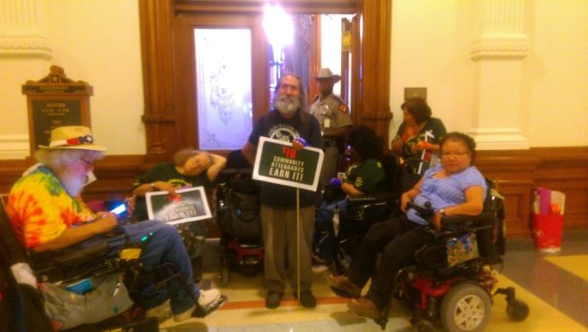 Members of ADAPT of Texas and PACT blockade the Texas Governor's office. May 19, 2015. (Kit O'Connell)