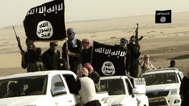 File: ISIS parades through the desert on stolen trucks. (Flickr / Day Ddonaldson)