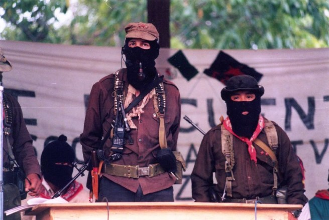 Two leaders of the Zapatistas, Marcos and Tacho, are seen with masked faces in this 1999 photograph taken in Chiapas, Mexico. (Flickr / Cesar Bojorquez)