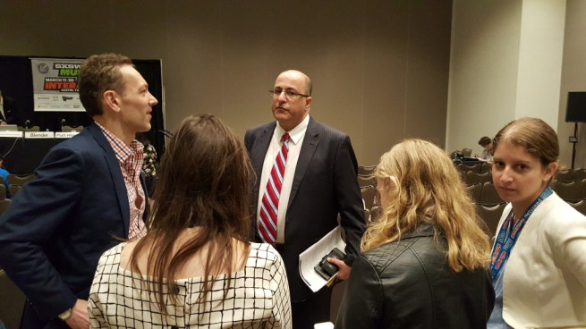 """Admirers surround Ido Aharoni (center), the consul general to the Israeli embassy in New York, before the panel """"Building The Perfect Country"""" at the SXSW Interactive conference in Austin, Texas on March 14, 2016."""