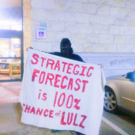 "An ""Anonymous gorilla"" (a protester in a gorilla suit) stood outside Book People in Austin, Texas on February 2, 2015 during George Friedman's book signing. The gorilla's banner reads ""Strategic Forecast Is 100% Chance Of Lulz."" (Kit O'Connell)"