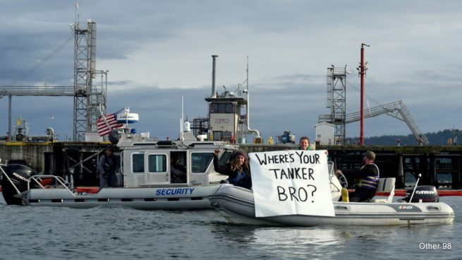 """Where's your tanker, bro?"" The Mosquito Fleet taunts Shell's on-water security crew with a snarky banner on May 15, 2016. (Other98)"