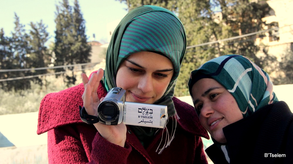 Palestinian volunteers with the B'Tselem human rights organization learn how to use video cameras to document the actions of the IDF and Israeli settlers in the West Bank, in 2014. (B'Tselem)