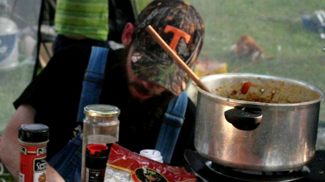 Will Coley prepares food for attendees at the 2014 Porcfest. (Photo: M4L)