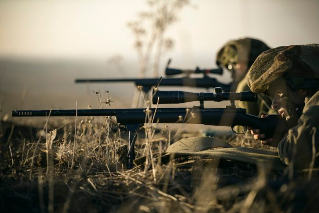 Israeli soldiers aim rifles during a large-scale military exercise on October 30, 2014. (Flickr / Israel Defense Forces / Gadi Yampel)