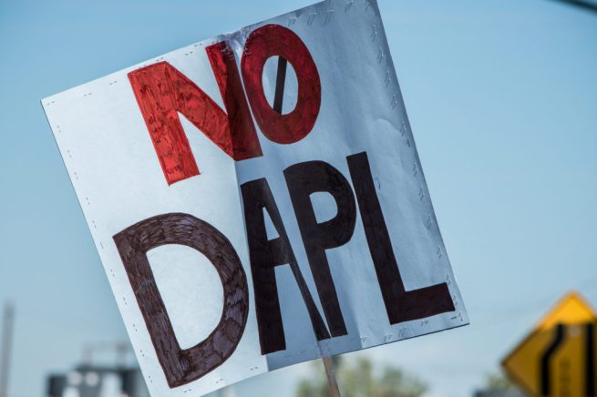 """A NoDAPL sign at a rally in solidarity with Native American """"water protectors"""" in North Dakota. (Flickr / Paulann Egelhoff)"""