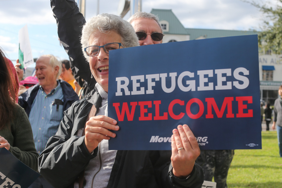 """An activist holds a """"Refugees Welcome"""" sign at a November 22, 2015 march in Houston, Texas. (Facebook / Elizabeth Brossa)"""