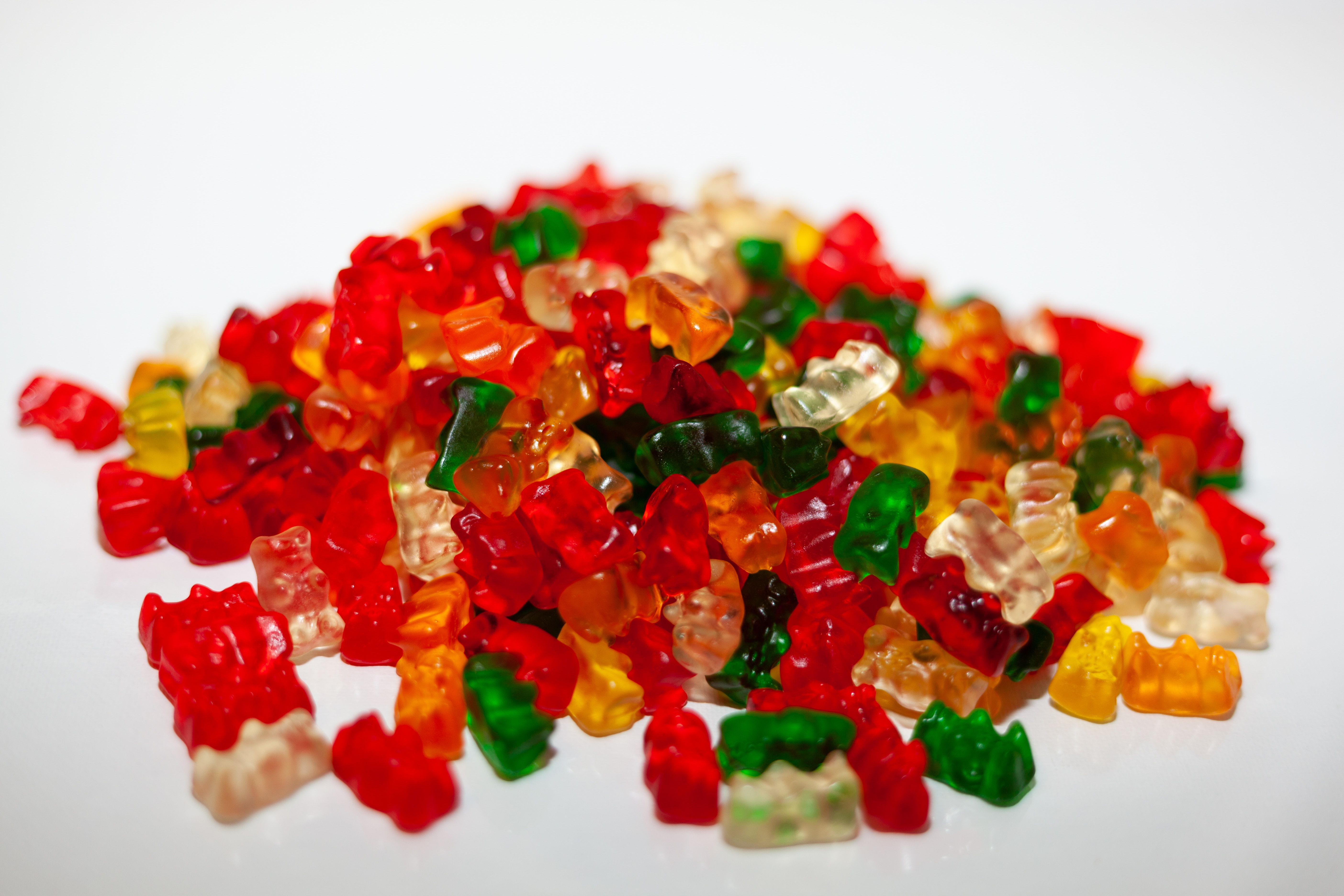A huge pile of gummy bears in a rainbow of colors.