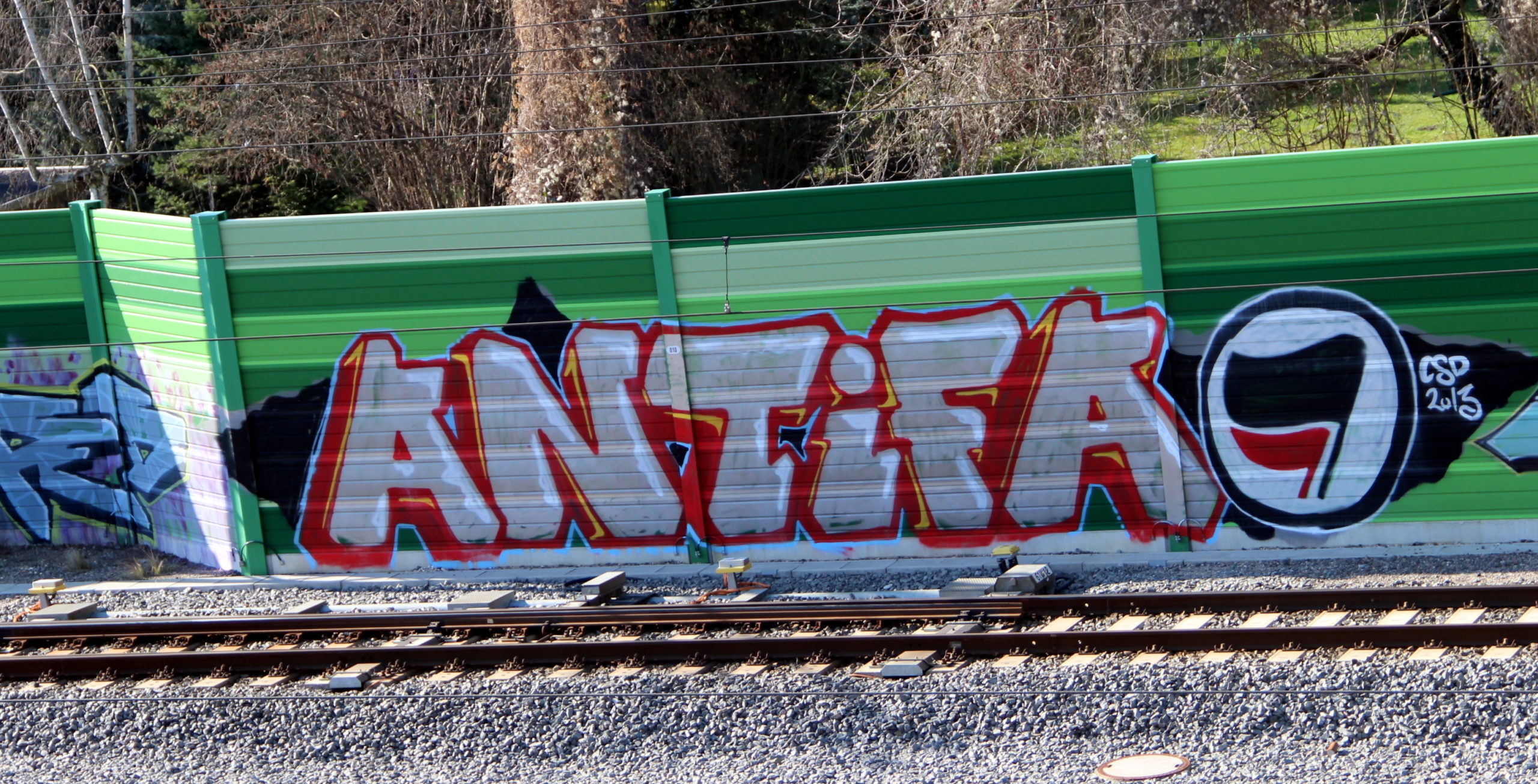 We're all antifa after the coup attempt. Photo: Graffiti along a railway line reads ANTiFA with the familiar black and red flags of the antifascist movement.