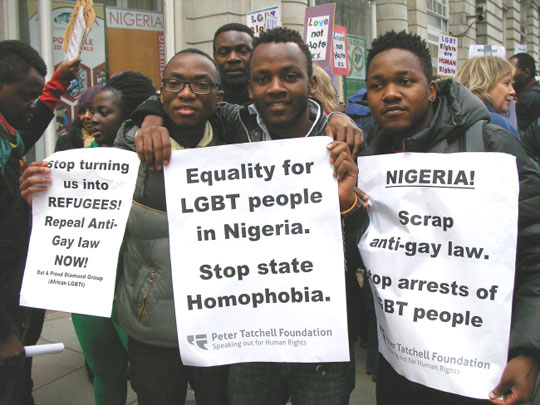 A gay demonstration to undermine the culture in Nigeria. Note that the signs are supplied by a pro-LGBT foundation in Britain