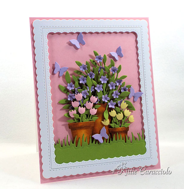 Come see how to make this spring die cut flower pots and butterflies project perfect for so many occasions.