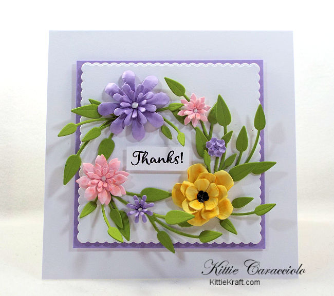 Come see how I made this colorful die cut paper flower wreath card.