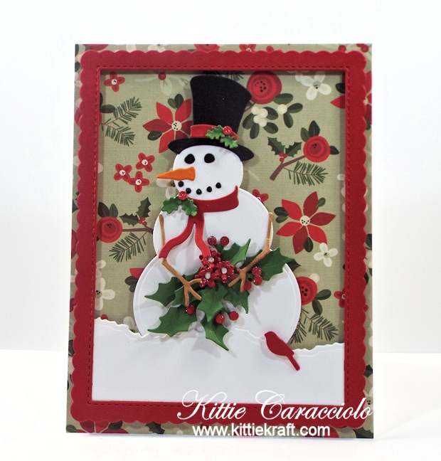 Come see how I made this fetive die cut snowman and holly card.