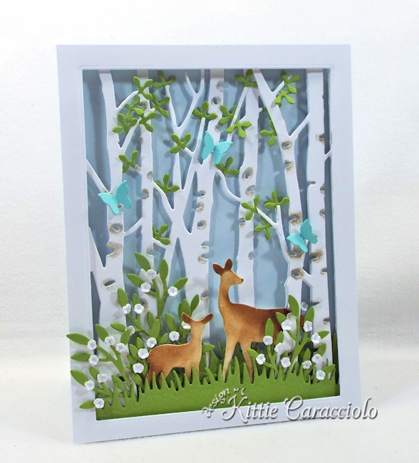 Come and see how I made pretty die cut birch tree scene.