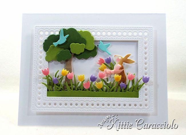 Come see how I made this sweet die cut spring bunny scene card.