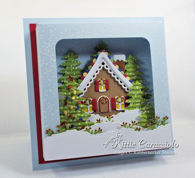 Come see how I made this snowy gingerbread house shadow box card.