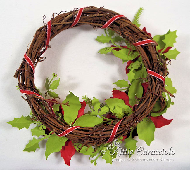 Click over to my blog to see how I made this paper poinsettia wreath.