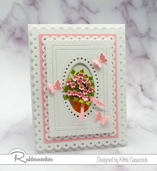 I love to use layered frames to highlight a small focal image.  Click on the picture to come over to my blog and see how I made this lovely card.