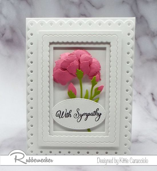 This handmade greeting card features an example of how to shape paper flowers using cardmaking die cuts