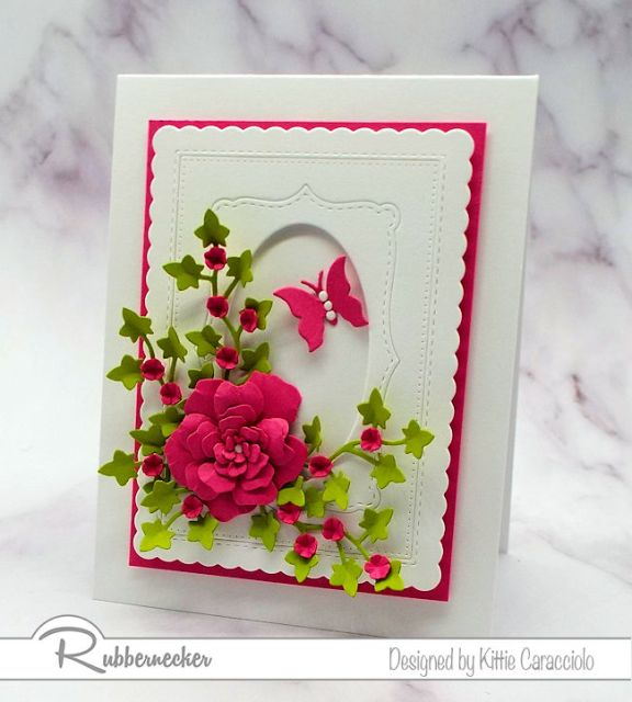 Bright paper flowers are the perfect focal image on an all white card front.  Click on the photo to come over to see how I made this beautiful card.