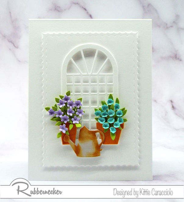 Click on the photo to come see how I create a beautiful white card with colorful flowers using dies made by Rubbernecker.