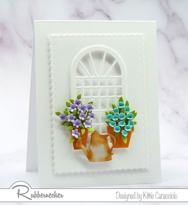Come see how I create a beautiful white card with colorful flowers using dies made by Rubbernecker.