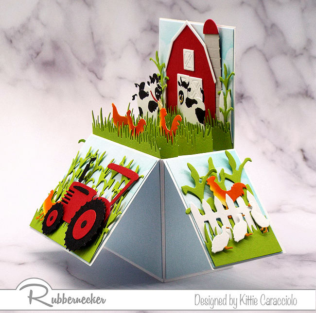 I pulled out all the farm themed dies that I had to create this dimensional farm pop up box card.  All dies are made by Rubbernecker.