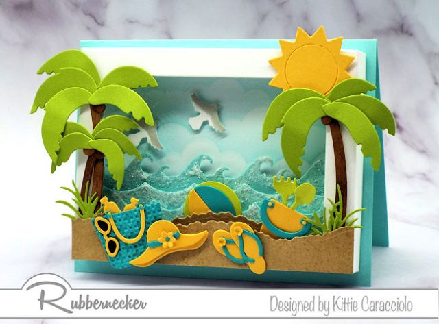 This shadow box frame beach scene is so fun and inviting with it'scolorful beach accessories and sparkly ocean waves.