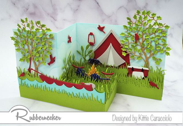 This Z Fold camping card is full of fun dThis Z Fold camping card is full of fun die cut images made by Rubbernecker that work together to create an interesting dimensional scene.ie cut images madeby Rubbernecker that work together to create an intereting dimensional scene.