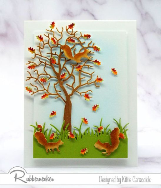 A dimensional fall card with squirrels and shaped leaves in an oak tree showing card making details