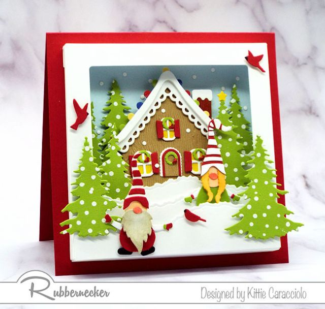 You can make this Gnome Shadow Box Card with its snowy cottage scene using die cuts from Rubbernecker