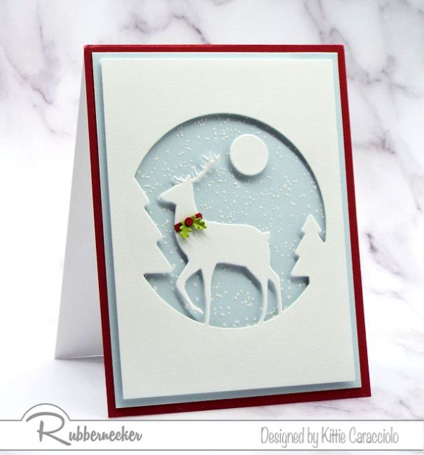A beautiful DIY winter greeting card made using a die cut White Deer Silhouette against a handmade snowy winter background