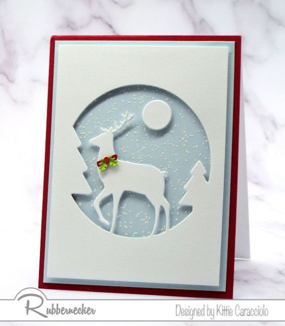 A White Deer Silhouette in a circle set against a handstamped snowy background to create a stunning DIY greeting card